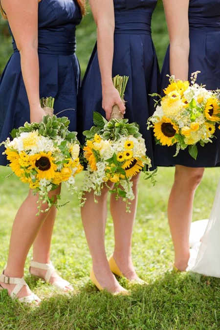 image-586313-navy-bridesmaid-dresses-sunflower-bouquets.jpg